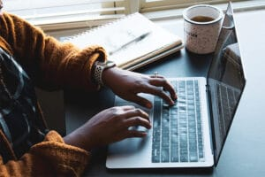 web designer typing on keyboard